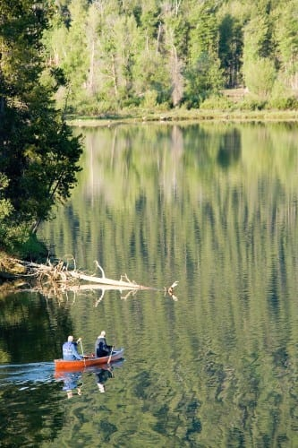 People canoing in wilderness
